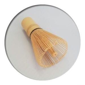bamboo matcha whisk on white background