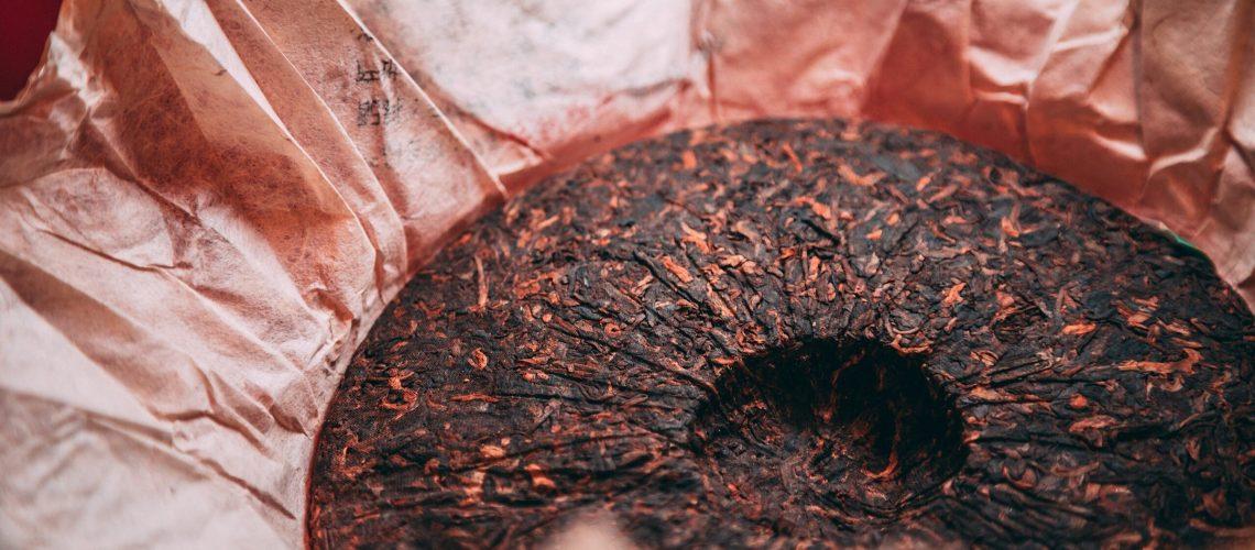 A Chinese Pu-Erh tea cake in a wrapper.