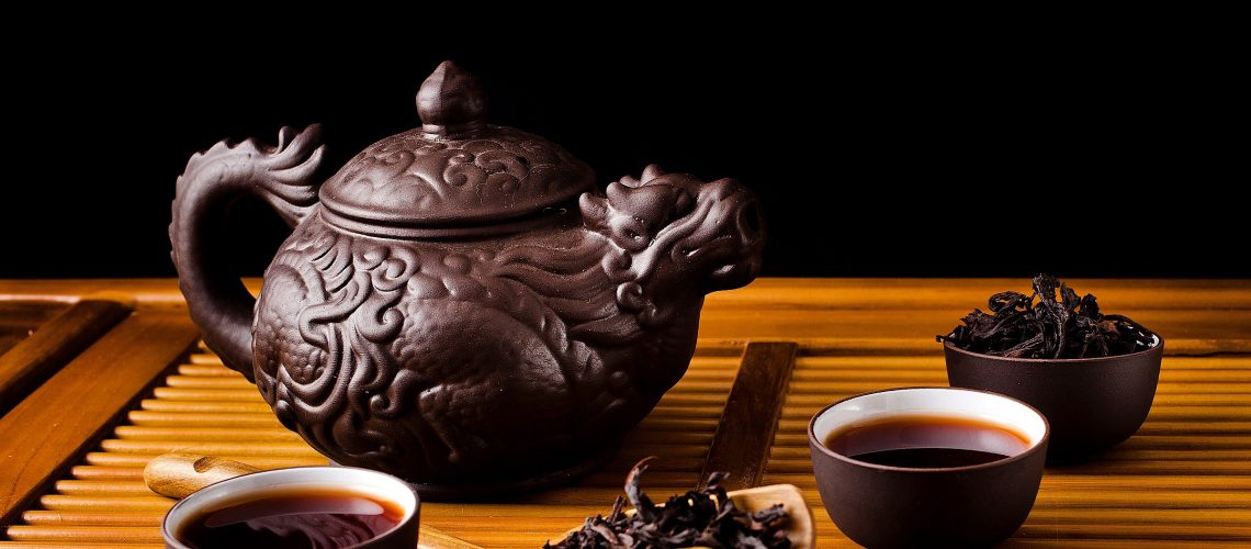 Chinese tea ceremony with clay pot and da Hong pao tea tea leaves
