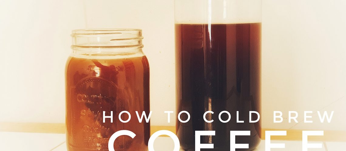 A large jar of cold brew black coffee and a glass mason jar of coffee with milk on a white table and background with the text how to cold brew coffee